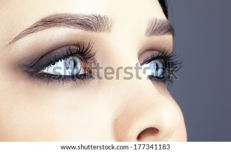 Closeup shot of woman eye with evening makeup - stock photo