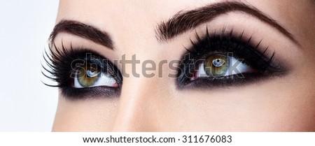 Closeup shot of woman eye with evening makeup. Long eyelashes. Smokey Eyes. - stock photo