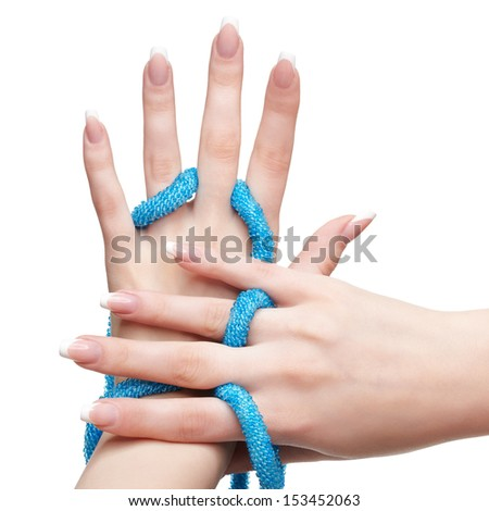 closeup shot of young woman's beautiful hands with blue beads on white - stock photo