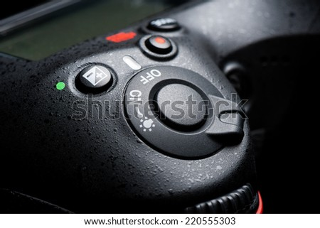 closeup shutter release button on professional DSLR camera - stock photo