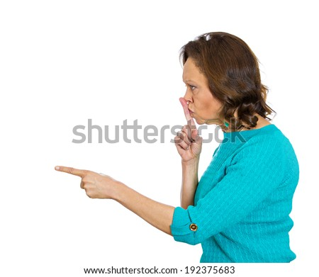 Closeup side portrait, headshot senior woman placing finger hand on lips, shh gesture, quiet silence isolated white background. Negative human facial expression, sign, emotion, feelings, body language - stock photo