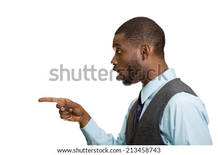 Closeup side view portrait handsome young man pointing with index finger at something, stunned dumbstruck looking at someone gesture isolated white background. Human emotion facial expression reaction - stock photo