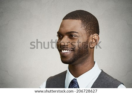 Closeup side view portrait, headshot, handsome happy, young business man, confident student, real estate agent, isolated black grey background. Positive face expressions, emotions, feelings, attitude - stock photo