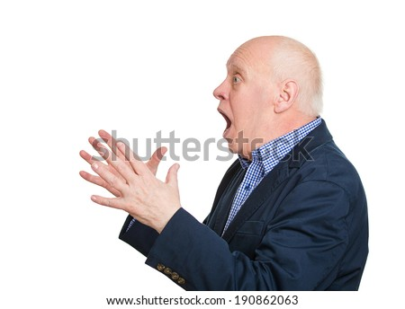 Closeup side view portrait, headshot senior mature man looking shocked surprised in disbelief hands in air, open mouth eyes, isolated white background. Positive human emotion facial expression feeling - stock photo