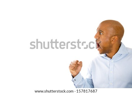 Closeup, side view portrait of handsome businessman in a blue shirt screaming at someone, looking very angry, isolated on white background with copy space. Human emotions and facial expressions. - stock photo