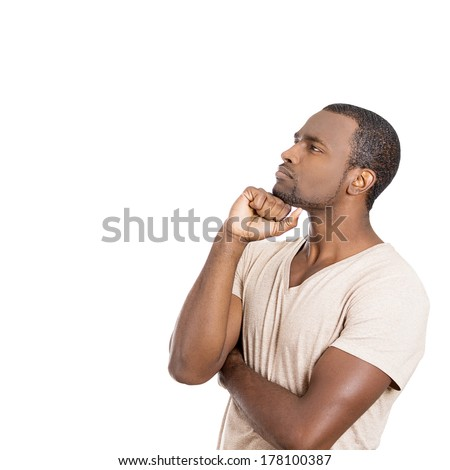 Closeup side view portrait of handsome young man, guy, student, employee, worker thinking, daydreaming, wondering, hand on chin, isolated on white background. Human face expression, emotions, reaction - stock photo