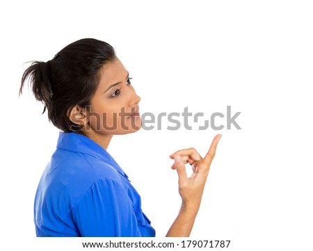 Closeup side view profile portrait of pretty, inquisitive looking young woman pointing with finger, trying to solve problem, isolated white background. Positive human emotion facial expression feeling - stock photo