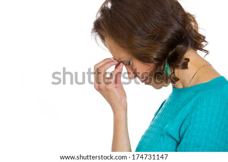Closeup side view profile portrait of sad alone dark gloomy frustrated stressed senior mature woman bending head down, having bad really bad nightmare day. Negative emotion facial expression feelings. - stock photo