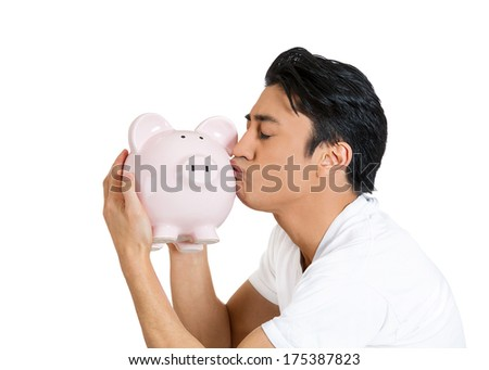 Closeup side view profile portrait of young happy successful enthusiastic affectionate sensitive man kissing piggy bank, isolated on white background.  Financial decisions, money savings, college fund - stock photo
