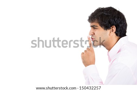 Closeup side view profile portrait of young man placing finger on lips as if to say, shhhhh, be quiet, isolated on white background with. Negative facial expression, human emotions signs and symbols - stock photo