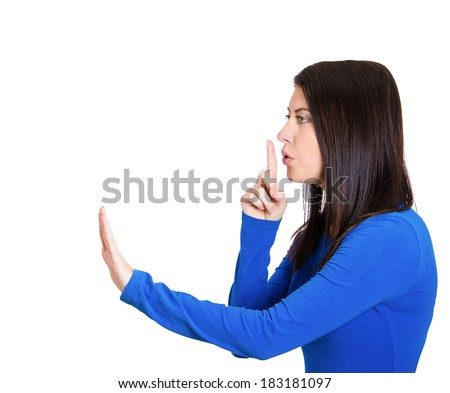 Closeup side view profile portrait, pretty young woman placing fingers on lips with shhh sign symbol, isolated white background. Negative emotion facial expression feelings, body language - stock photo