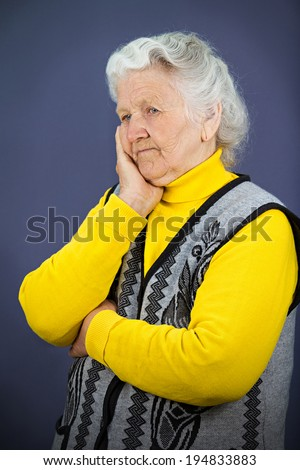 Closeup side view profile portrait sad alone, gloomy, frustrated stressed, senior, mature woman head on hand, having bad nightmare day, thinking, isolated blue background. Negative emotion, expression - stock photo
