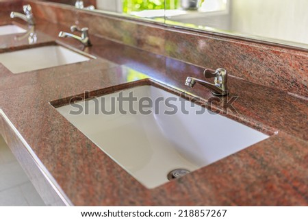 Closeup sinks in the toilet. - stock photo
