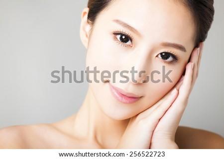 closeup smiling young  beautiful  woman face  - stock photo