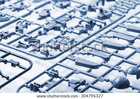 closeup sprue or injection molding of toy - stock photo