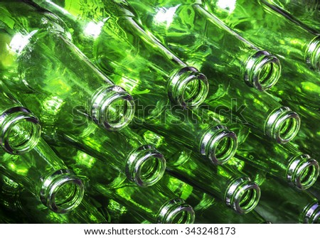 Closeup stack of green color bottles background - stock photo