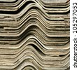 Closeup stack of old asbestos tile roofs - stock photo