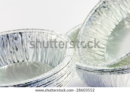 closeup - stacks of small round catering trays on a white background - stock photo