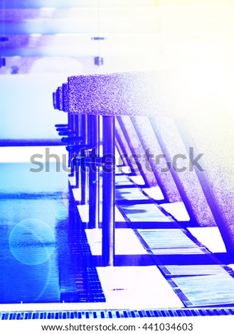 Closeup starting platforms in the swimming pool - stock photo