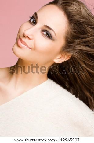 Closeup studio portrait of a striking brunette beauty. - stock photo