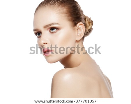 Closeup studio portrait of attractive model with professional makeup on white background. Perfect skin. Blue eyes. Brunette hair. Isolated - stock photo