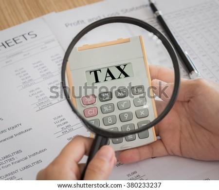 closeup tax on calculator. concept of taxes,tax return, taxation, tax refund, tax preparation. - stock photo