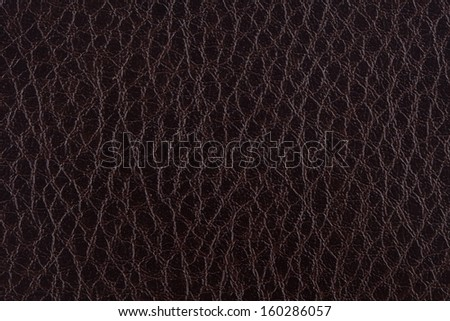 Closeup texture of dark brown leather for background - stock photo