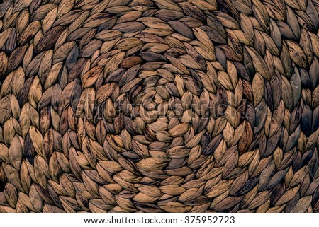 Closeup texture of dark brown wicker woven pattern for background - stock photo