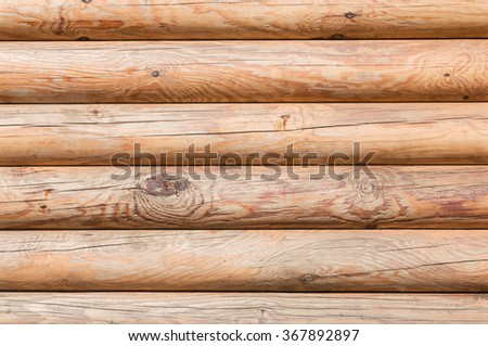 Closeup texture of the walls made of logs in the sun, background - stock photo