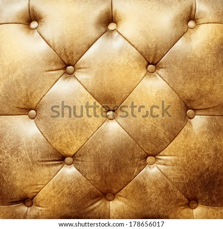Closeup texture of vintage brown leather sofa for background  - stock photo