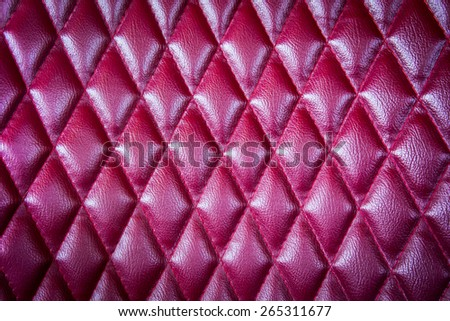 Closeup texture of vintage red leather sofa for background - stock photo