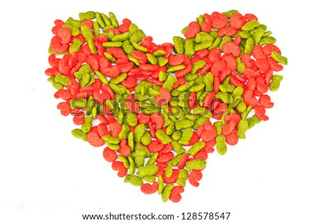 Closeup the feed on white and heart shape ,  can use background - stock photo