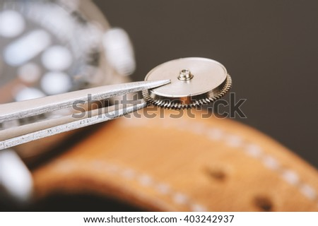 closeup the parts of automatic wristwatch, Mainspring - stock photo