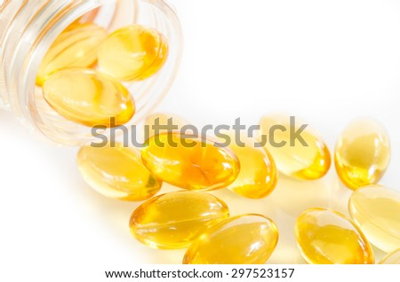 Closeup the yellow soft gelatin supplement omega 3 , fish oil capsule - stock photo