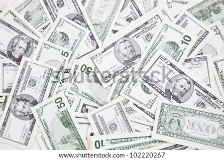 Closeup to a bunch of dollar bills - money concepts - stock photo