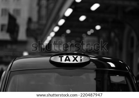 Closeup to a London Taxi Sign - stock photo