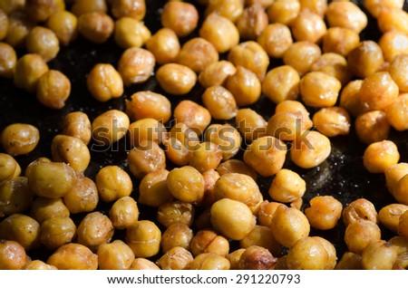 closeup to crispy roasted chickpeas - garbanzo beans - stock photo