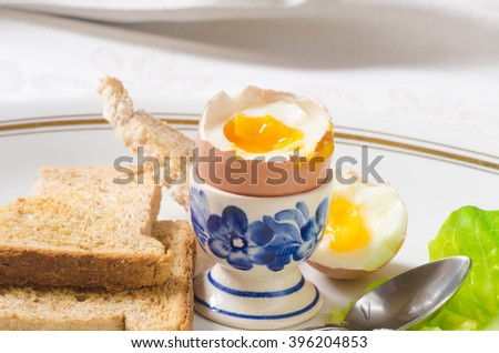 closeup to soft boiled egg - stock photo