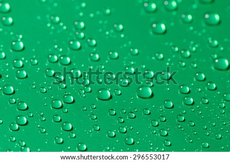 closeup to waterdrops on blue background, selective focus - stock photo