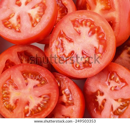 Closeup tomatoes sliced in half - stock photo