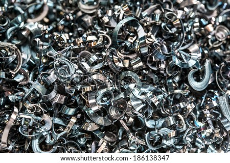 Closeup twisted spiral steel shavings. Drilling milling and lathe industry. - stock photo