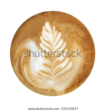 Closeup up of coffee latte foam with leaf design art isolated on a white background, viewed from top. - stock photo