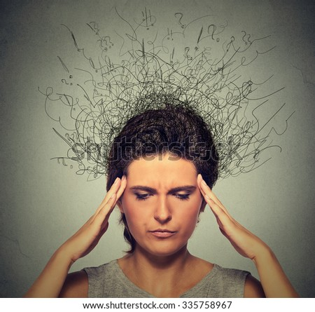 Closeup upset young woman with worried stressed face expression frowning and brain melting into lines question marks. Obsessive compulsive, adhd, anxiety, ocd disorders  - stock photo