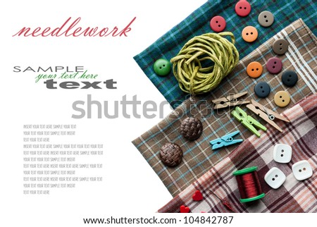 Closeup various sewing supplies lying on the fabric (with easy removable text). Horizontal composition. - stock photo
