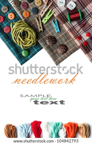 Closeup various sewing supplies lying on the fabric (with easy removable text). Vertical composition. - stock photo