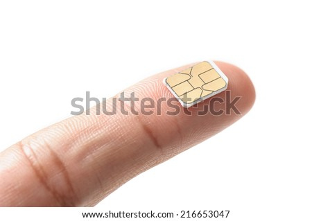 closeup very small Nano SIM card on finger - stock photo