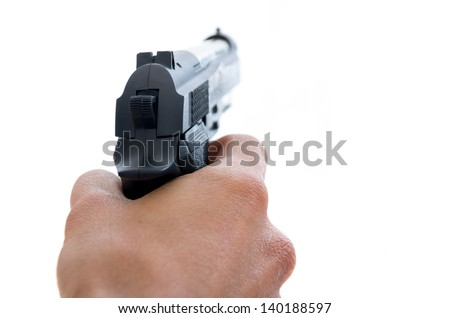 Closeup view from behind of a male hand holding a pistol taking aim away from the camera with shallow depth of field on a white background - stock photo