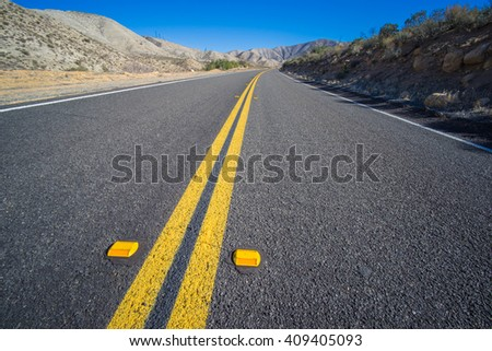 Closeup view in detail of freshly paved asphalt road in the desert. - stock photo