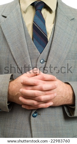 Closeup view of a businessman with clasped hands, patiently waiting for something - stock photo