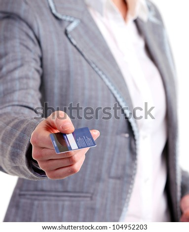 Closeup view of a female holding a plastic card. Image with shallow depth of field, hand in focus. - stock photo